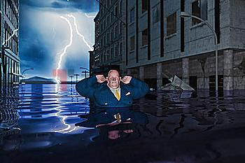 Overweight businessman with fingers in ears in flooded city