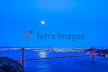 Moon in night sky over Golden Gate Bridge, San Francisco, California, United States