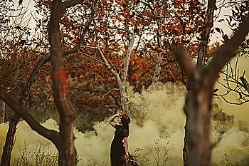 Caucasian woman standing in fog in forest