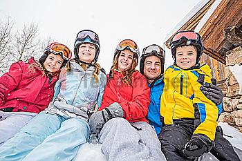 Portrait of smiling Caucasian family on winter vacation