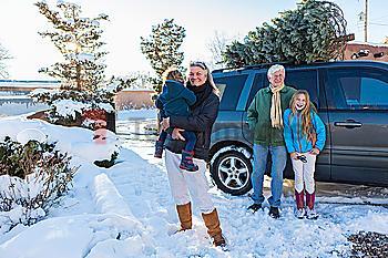 Caucasian family smiling in snow