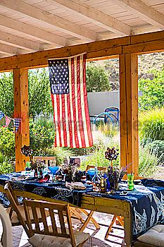 American flag hanging on patio near table