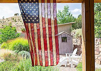 American flag hanging in backyard