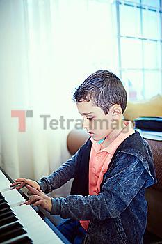 Hispanic boy playing piano