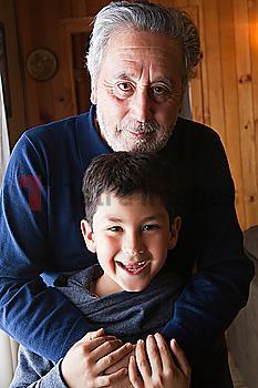 Portrait of smiling Hispanic grandfather and grandson
