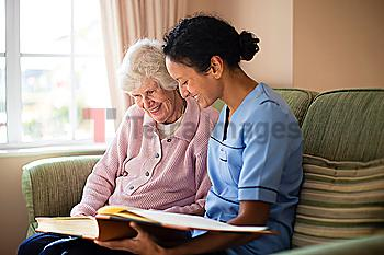 Nurse and patient looking at photo album
