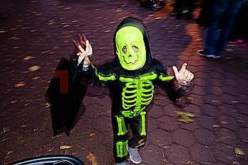 Caucasian boy wearing skeleton Halloween costume