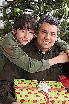 Hispanic father and son on Christmas