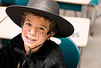 Close up portrait of mixed race boy in costume