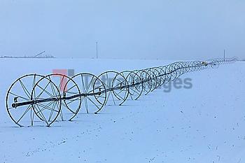 Sprinkler system in field during winter