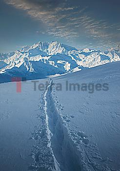 Tracks through snow by Monte Rosa in Piedmont, Italy