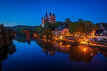 Limburg Cathedral by river at night in Limburg, Germany
