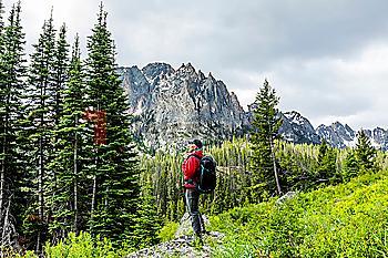 Senior man hiking by mountain in Stanley, Idaho, USA