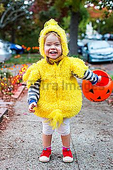 Smiling Caucasian girl wearing chicken costume on Halloween