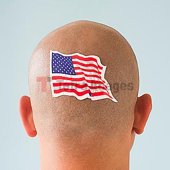 Back view of man with American flag tattoo on head