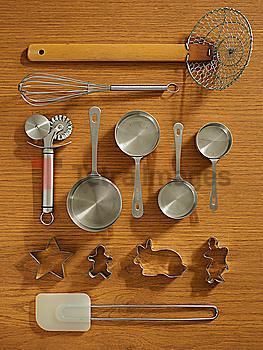 Studio shot of kitchen utensils on wooden table