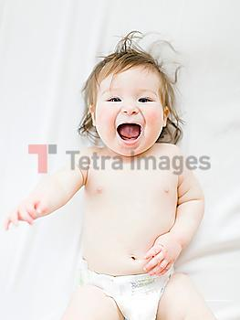 View directly above baby girl with her mouth open