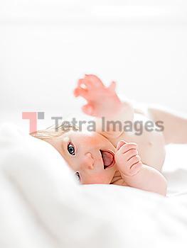 Baby girl lying on her side