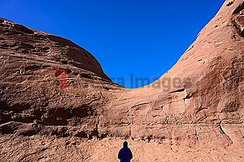 Silhouette of woman by rock formation in Monument Valley, Arizona, USA
