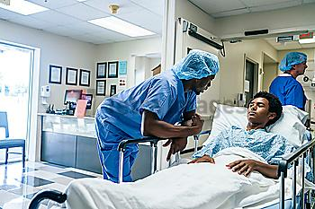 Nurse talking to teenage patient