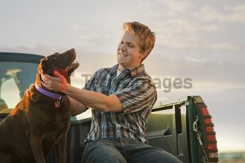 Caucasian man sitting in truck with dog