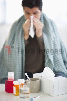 USA, New Jersey, Jersey City, Man with flu, blowing nose