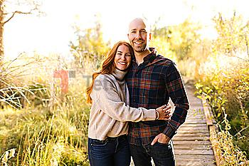 Smiling couple on forest boardwalk