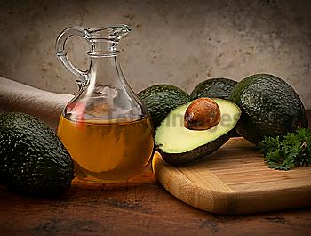 Avocados with pitcher of oil
