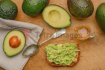 Avocado on toast with spoon and oil