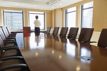 Businessman standing in board room
