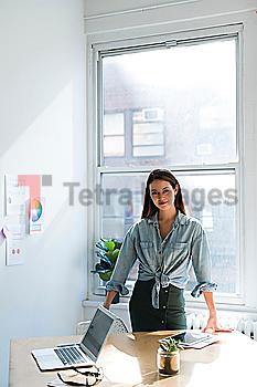 Business woman standing behind office desk