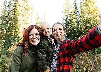 Family selfie in forest