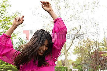 Smiling woman dancing
