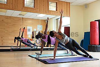 Women doing yoga in gym