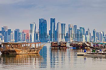 Boats by skyscraper skyline in Doha, Qatar