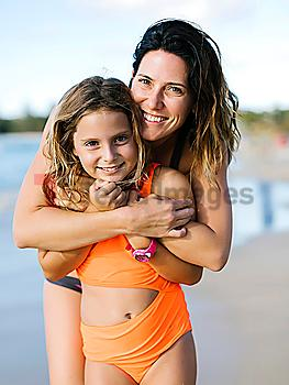 Woman with her daughter on beach