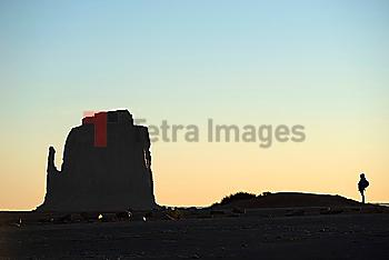 Silhouette of woman by butte in Monument Valley, Arizona, USA