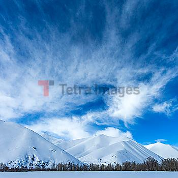Snow covered mountains under clouds in Sun Valley, Idaho, USA