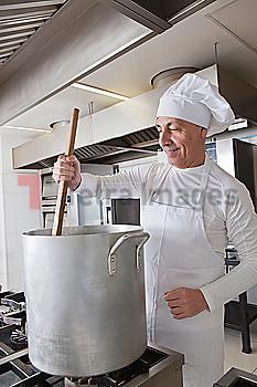 Chef stirring pot