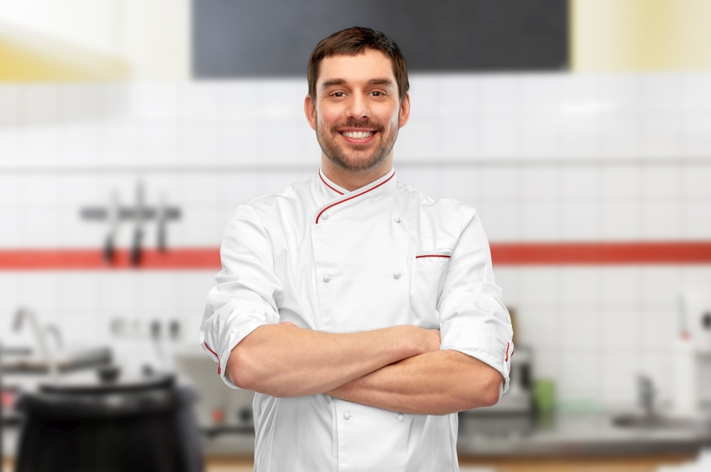 cooking, culinary and people concept - happy smiling male chef in jacket with crossed arms over grey background. happy smiling male chef with crossed arms