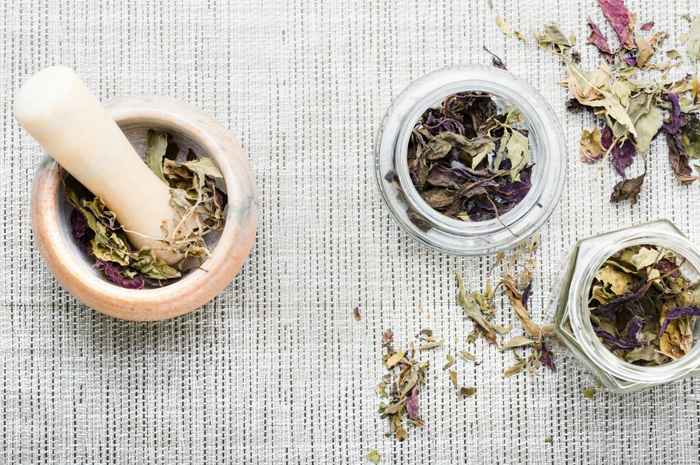 Dried natural basil spice.Dried basil leaves herbs.Condiment. Dried herb,crushed basil leaves