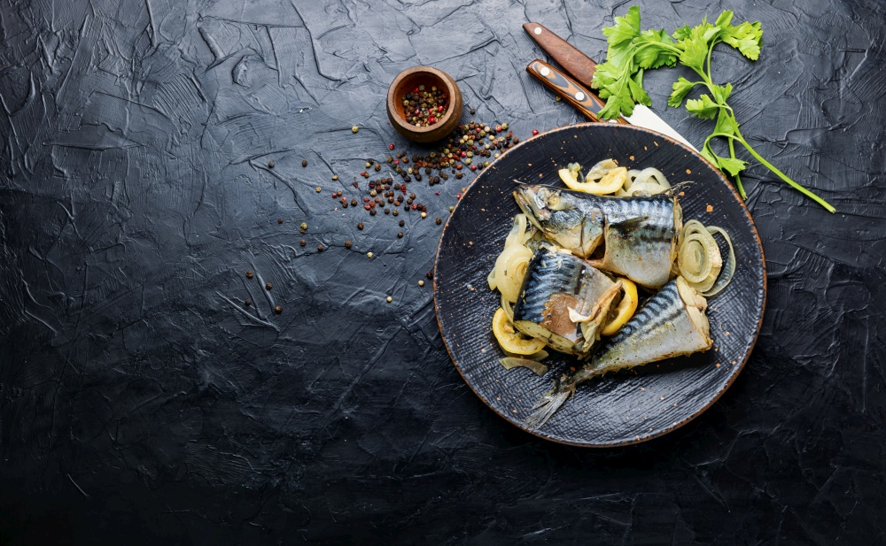 Steamed mackerel pieces on a plate.Diet food.Space for text. Baked or steamed fish mackerel,copy space