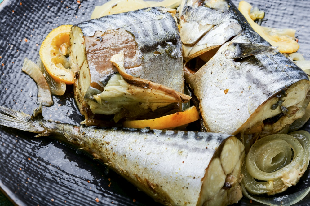 Steamed mackerel pieces on a plate.Fish stew.Diet food.Food background. Baked or steamed fish mackerel,close up
