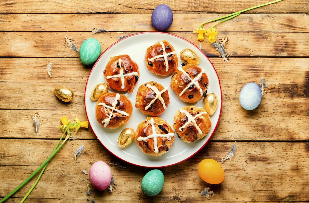 Easter hot cross buns and holiday decor.Easter baked goods. Homemade Easter buns