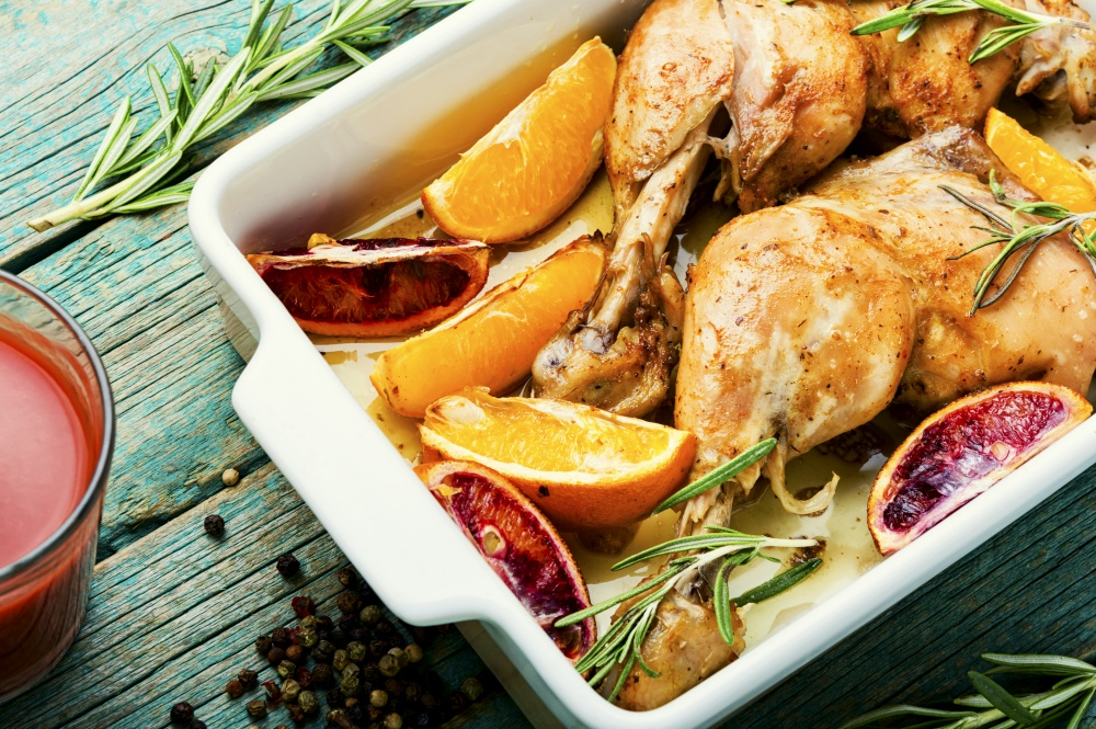 Grilled chicken meat with orange sauce and rosemary.Homemade food. Roasted chicken with oranges