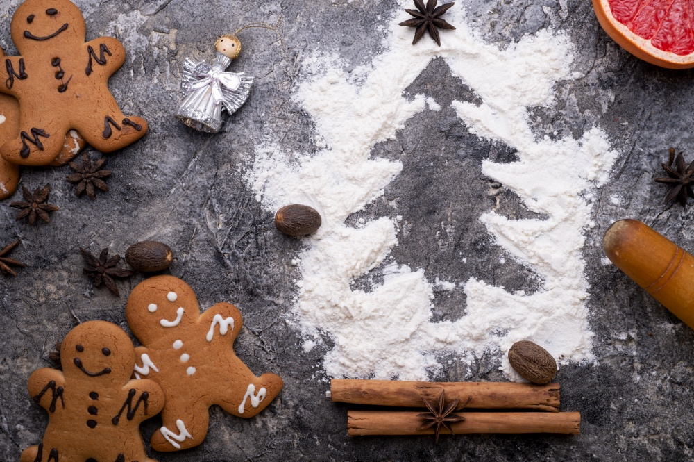 christmas decorative cookies with flour christmas tree. christmas background around grey background