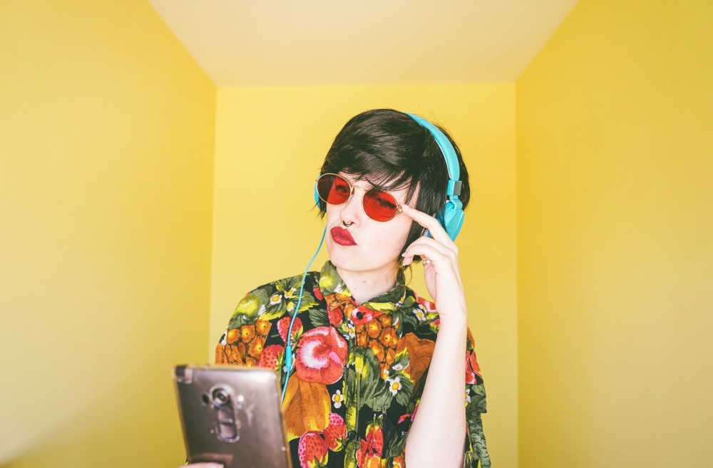 Cool young androgynous dj woman