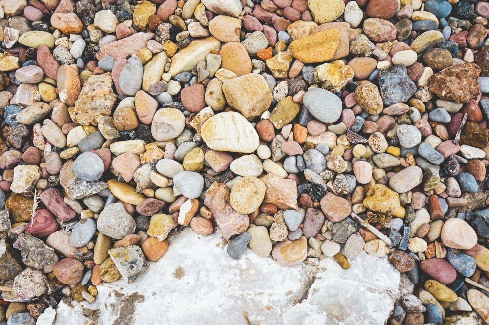 Variety of stones in a stone shore in the coast