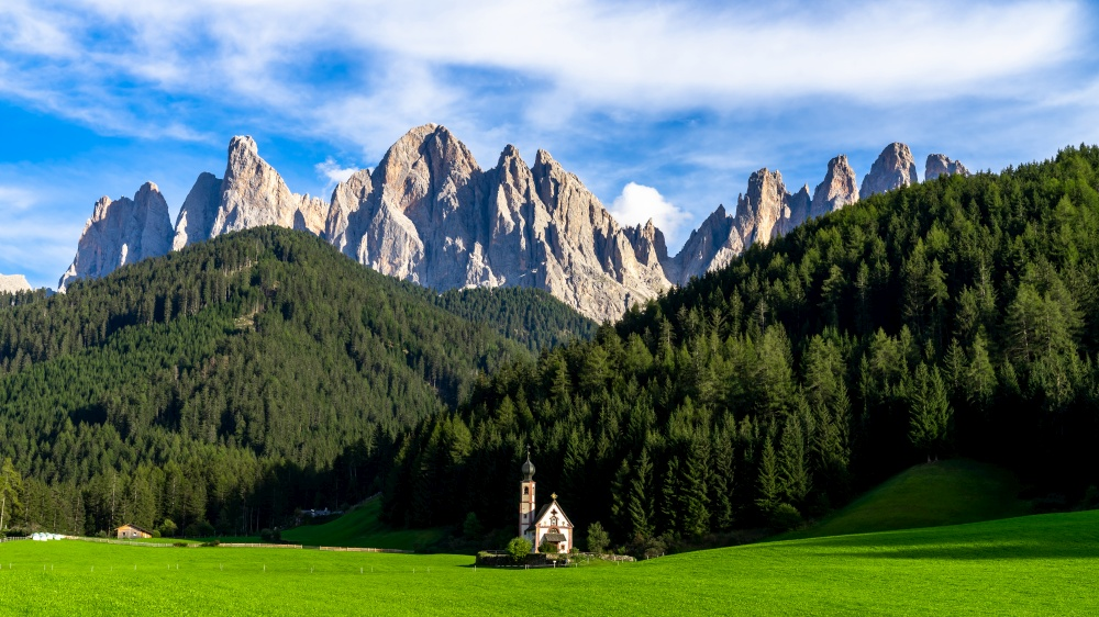 Famouse church in Santa Maddalena village, Village in the Dolomites mountain peaks in St. Magdalena or Santa Maddalena with characteristic church, South Tyrol, Italy